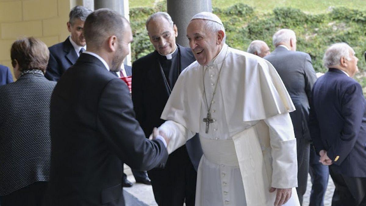 Francisco junto al ministro de Economía